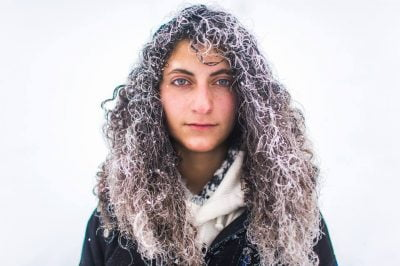 Woman Standing With Snow In Her Hair.