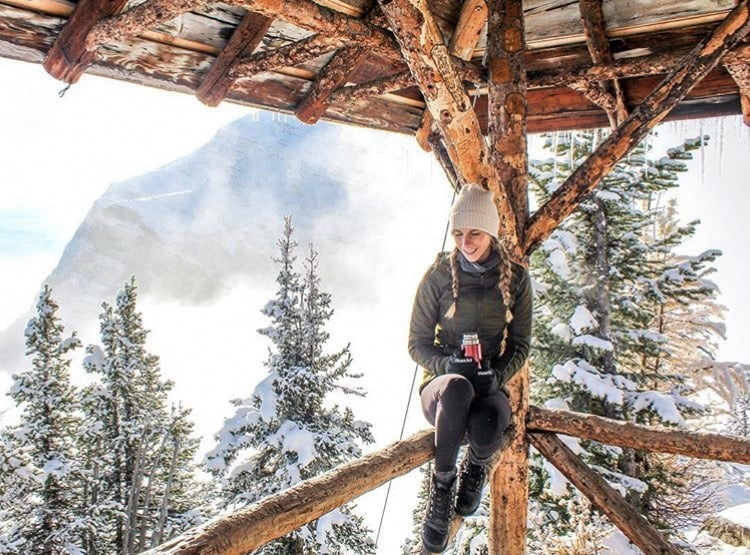 Woman Sitting In Big Beehive Shelter. 5 Best Hikes: Banff, Alberta