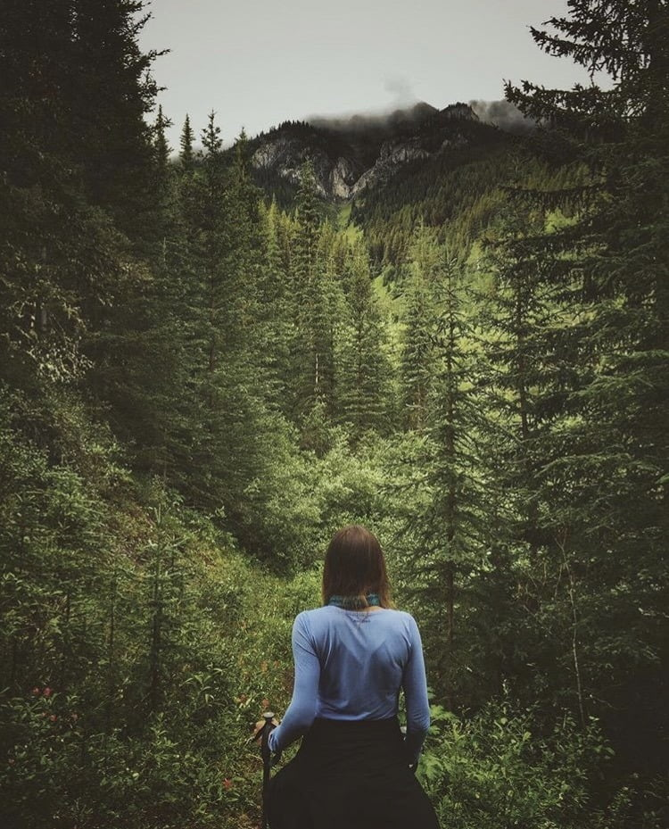 Lady walking in forest to Cascade Amphitheatre. 5 Best Hikes: Banff, Alberta
