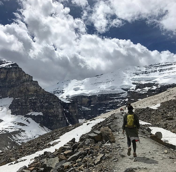 People Walking Along Narrow Trail. Plain Of The 6 Glaciers. 5 Best Hikes: Banff, Alberta
