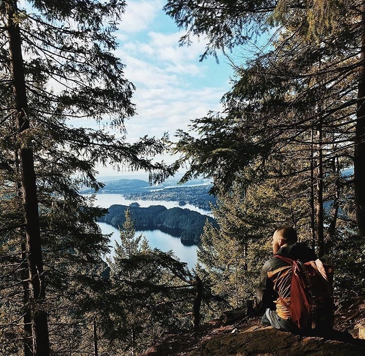 Person sitting overlooking a vista: Diez Vistas hike, Vancouver