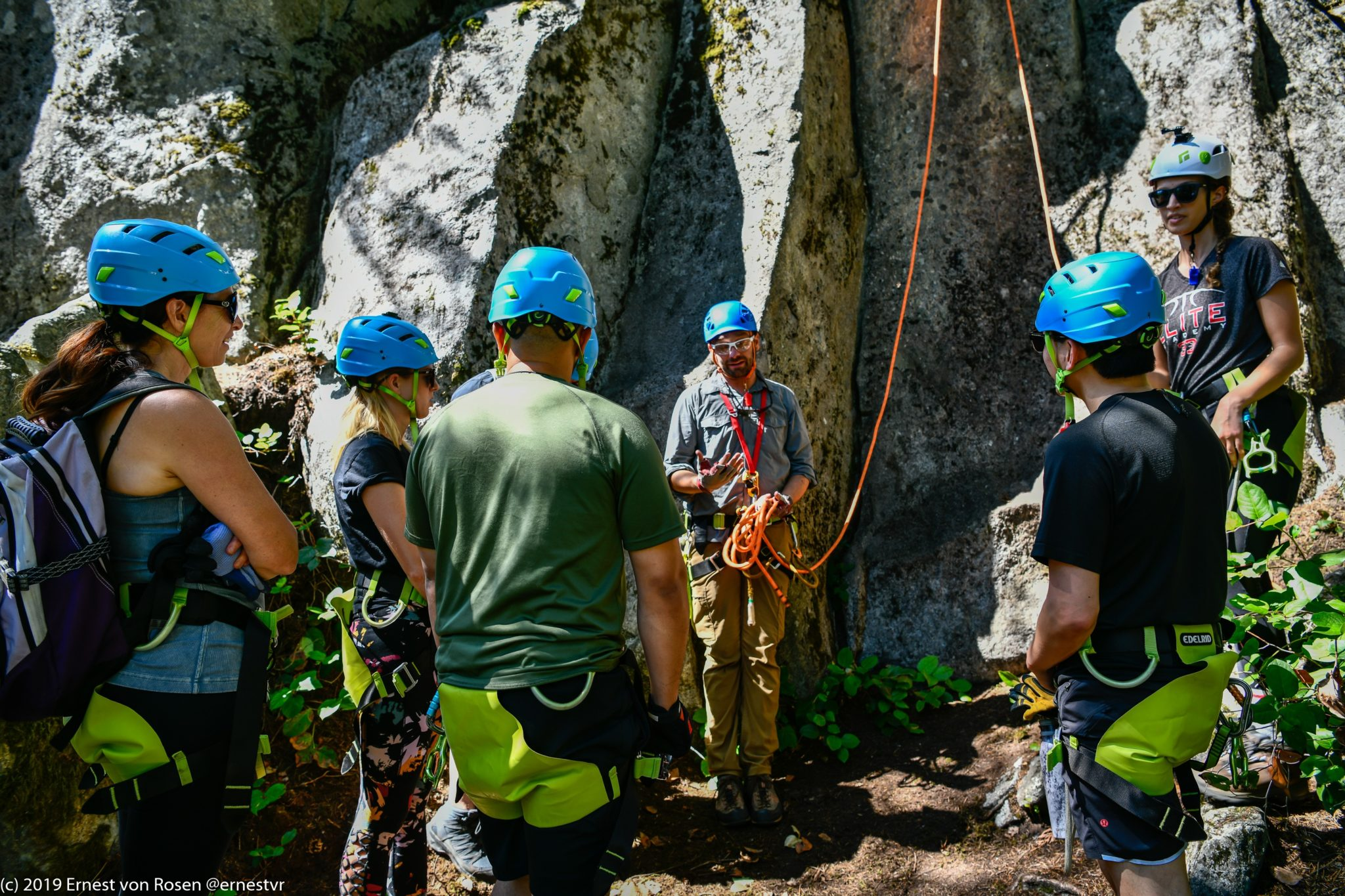 FX with a group at the bottom of a crag explaining how to use ropes to rappel