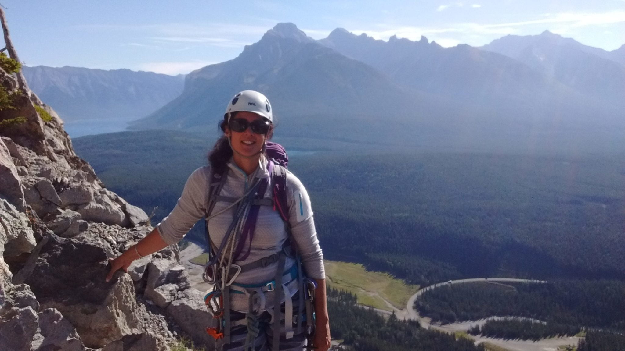 Woman rock climbing in Banff, Canada