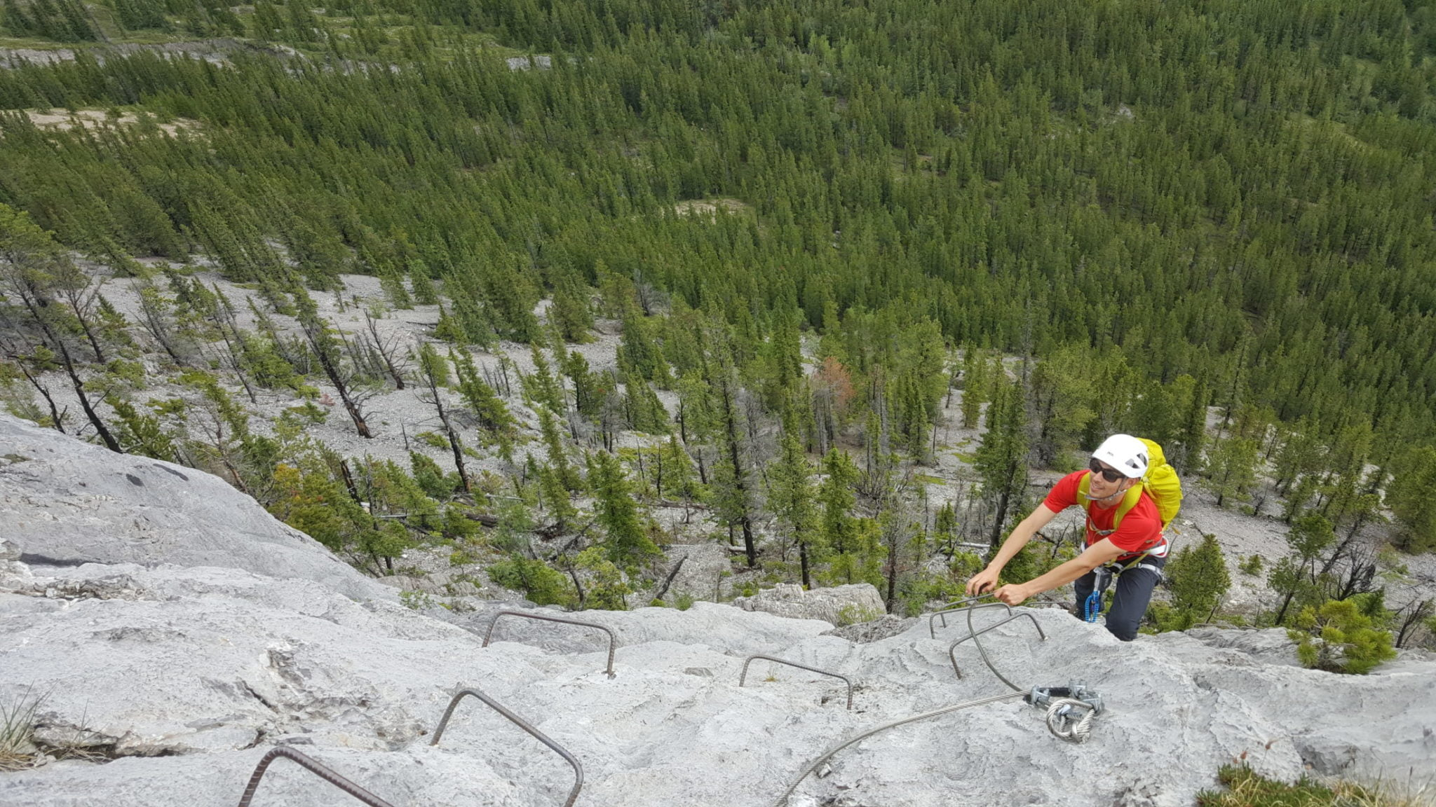 A man climbing the Mt Stelfox Via Ferrata