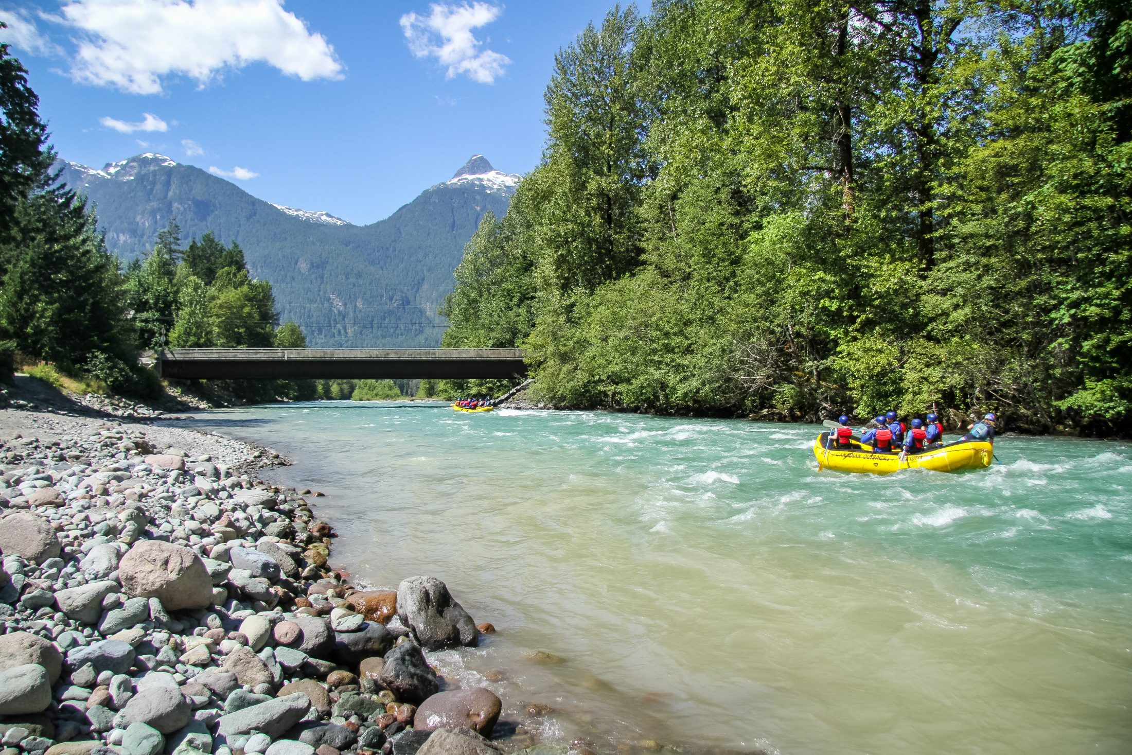 A Group Rafting On A Blue River In Squamish, British Columbia