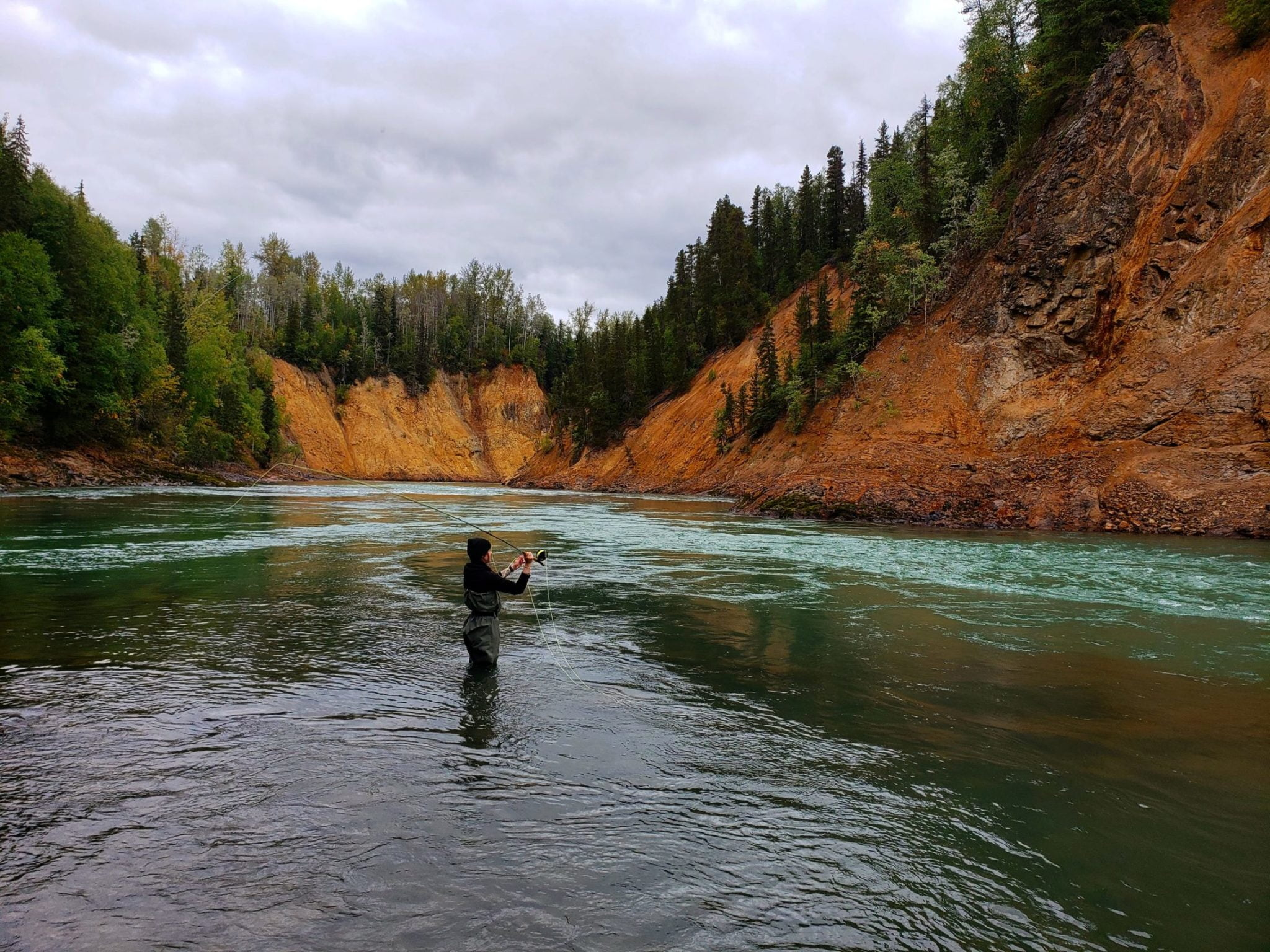 Woman fishing in a river in BC