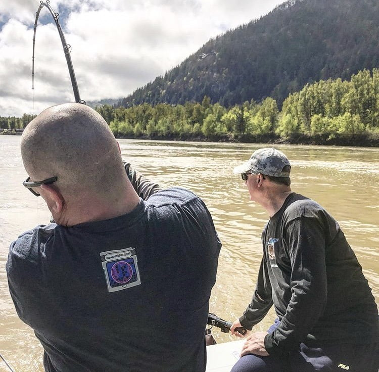 two men river fishing in bc