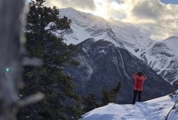 Person Taking In Winter View Of Mountains Near Canmore