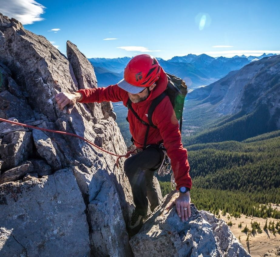 A man rock climbing outdoors in Alberta, Canada