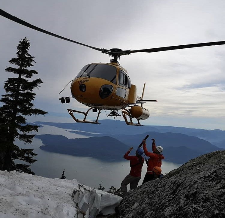SAR helicopter flying out of backcountry