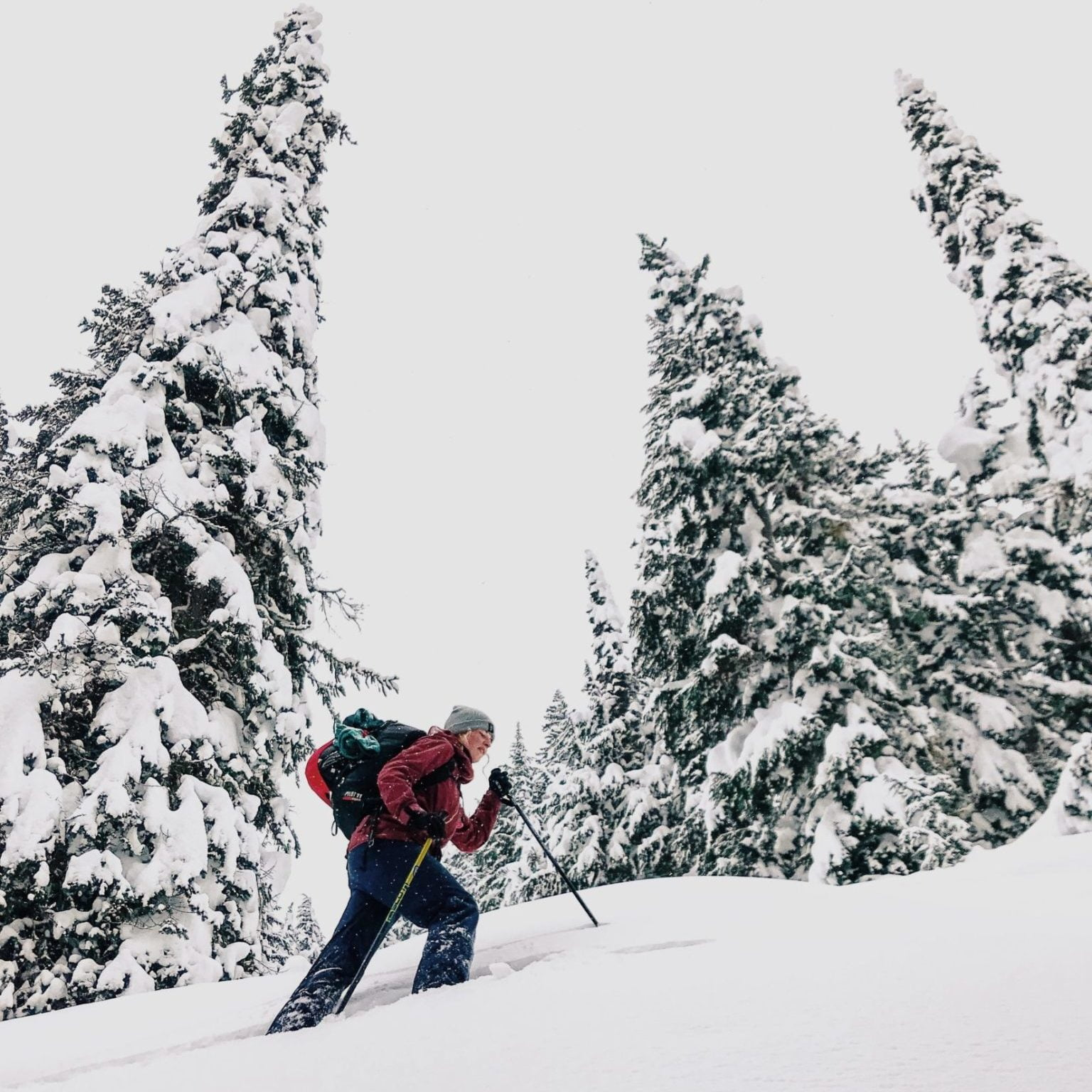 Man traversing in backcountry snow