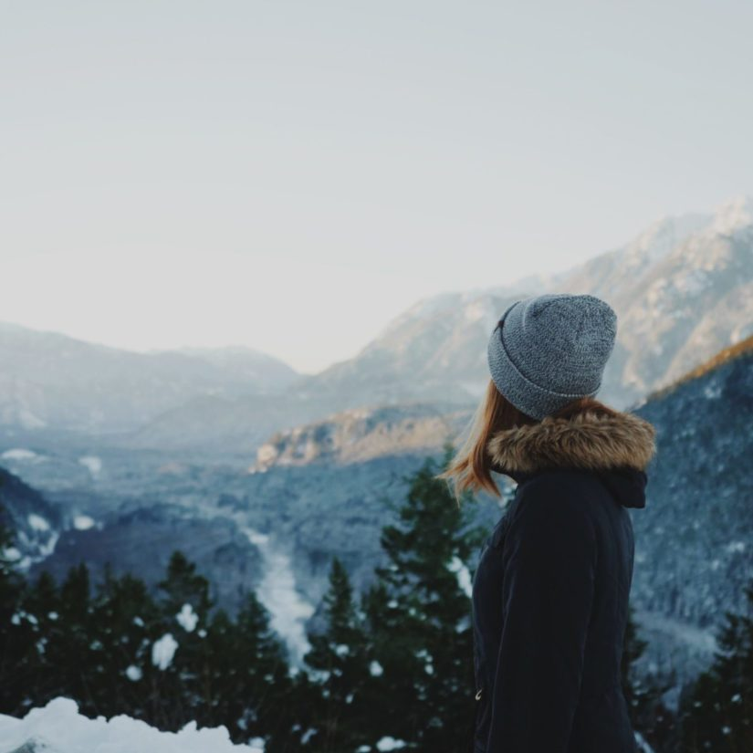 Girl Looking Out Over A Snowy Landscape