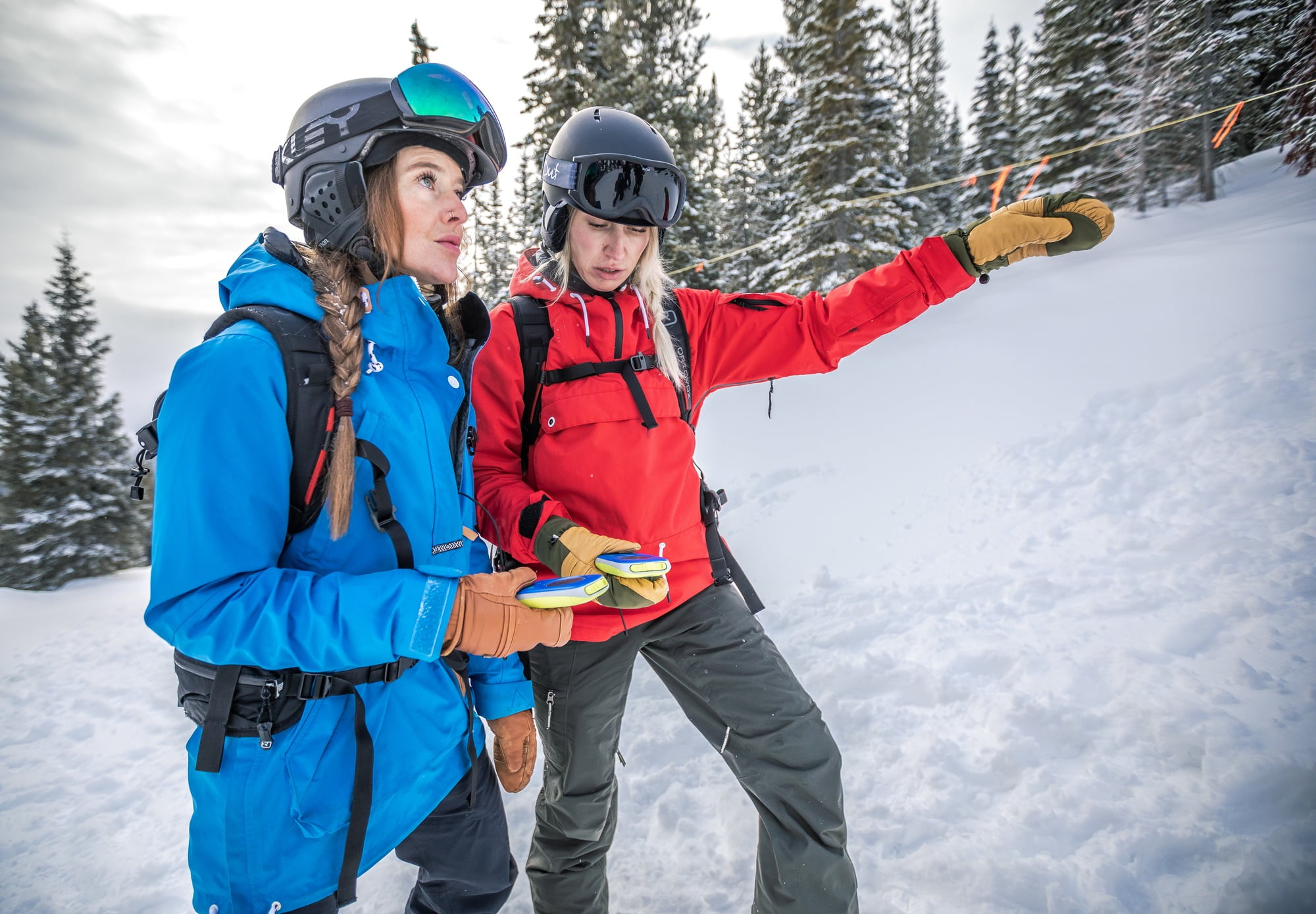 Ladies reviewing avalanche safety in backcountry skiing destination