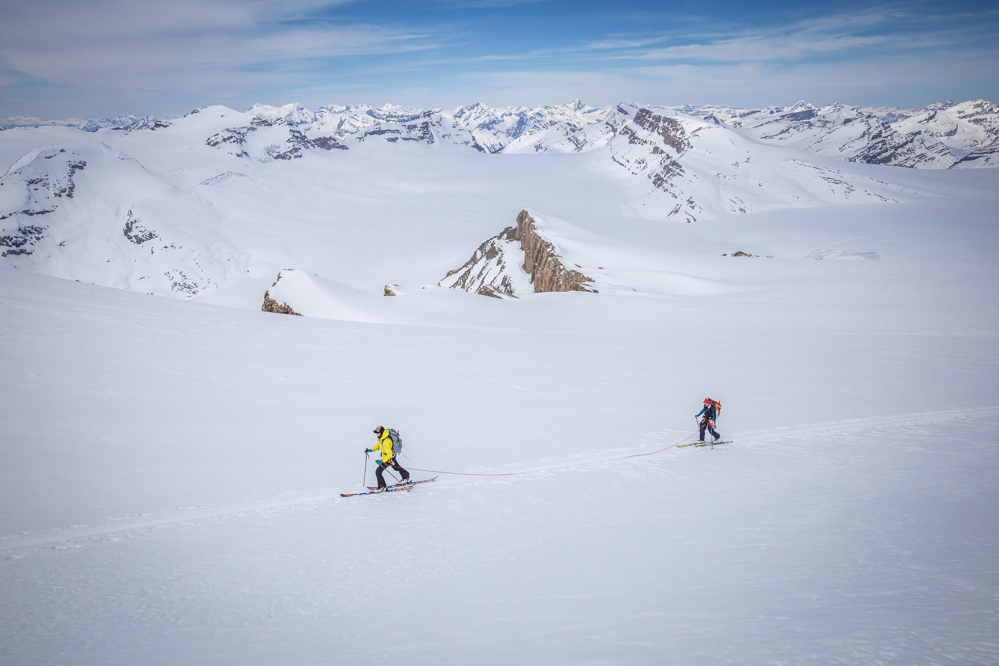 2 people traversing over a backcountry skiing destination: Canada