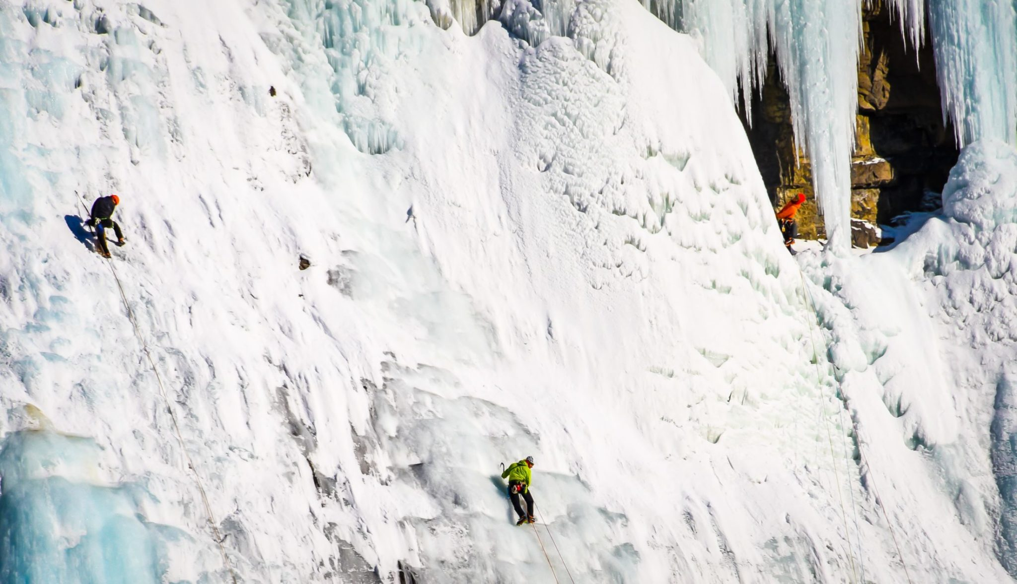 A Group Of Ice Climbers At Ice Fields Parkway In Alberta