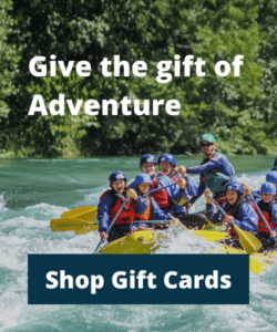 A group of people rafting on a blue river. Text: Give the gift of adventure. Shop gift cards