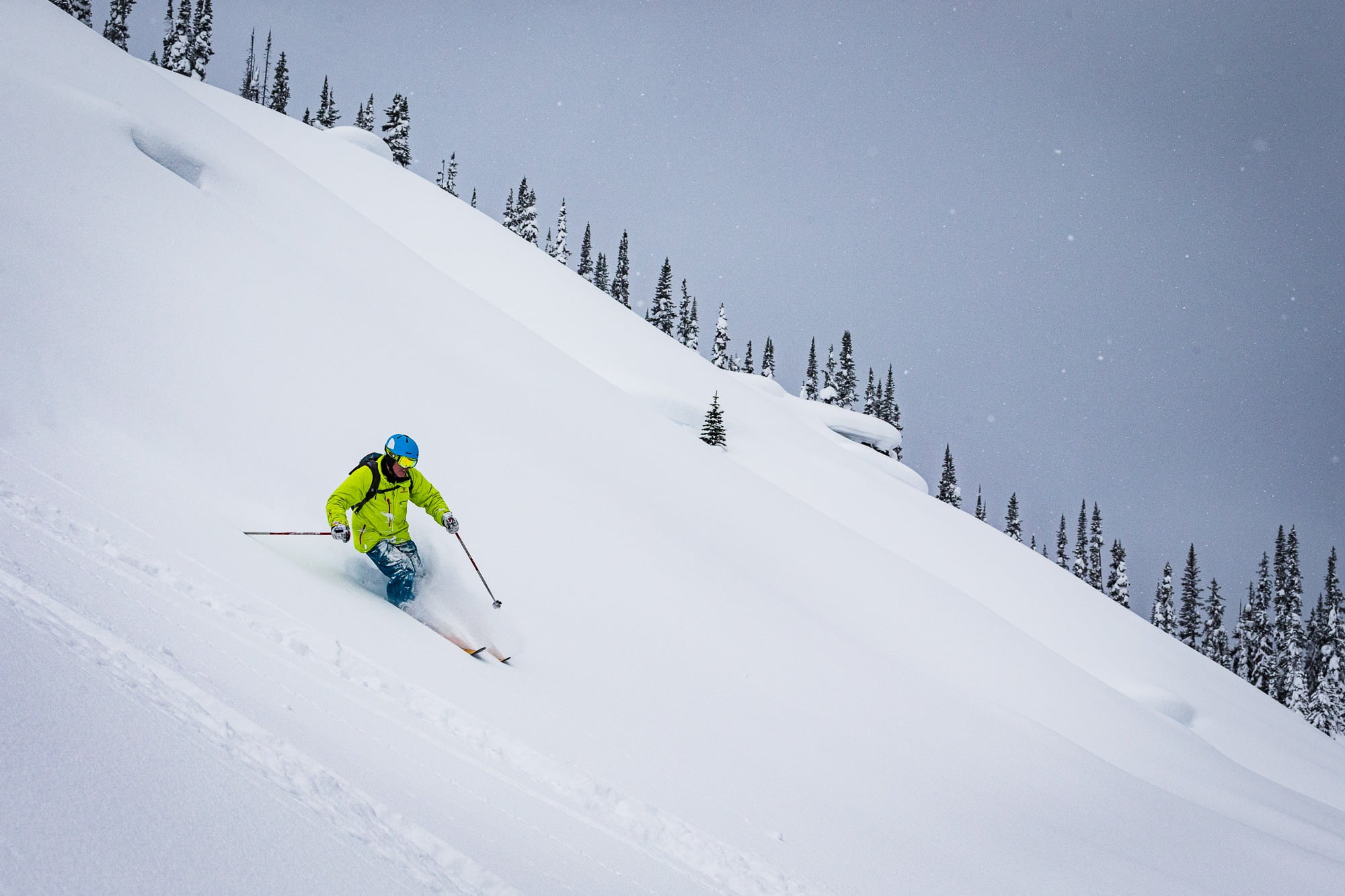 A Person Heli Skiing On A Snowy Day