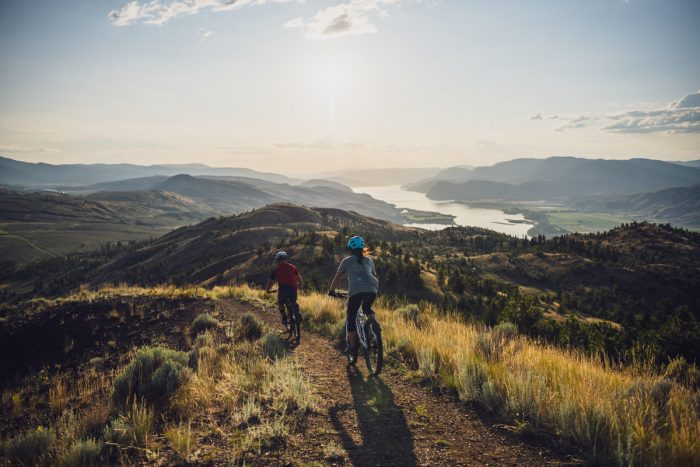 Two People Riding Mountain Bikes In Kamloops, BC
